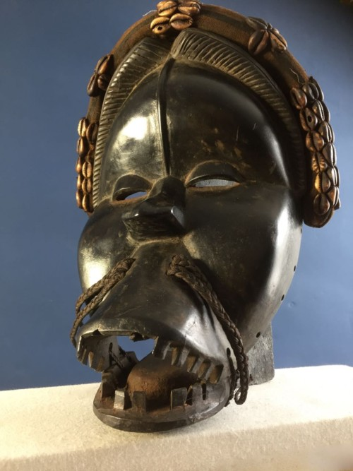 Dan Yacoba Mask Carved wod with hinged mouth. Cowrie  shells, human hair and woven fabric 32 x 24 x 13cm£450